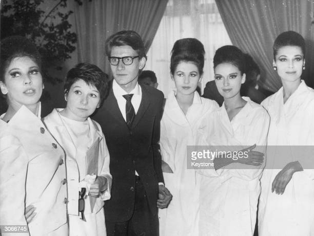 French fashion designer Yves St Laurent poses with a few of his models at a Paris fashion show On the left are client and friend Renee 'Zizi'...