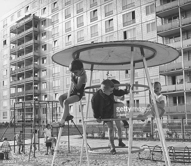 A group of children enjoy themselves on a climbing frame in the playground at Singerstrasse East Berlin