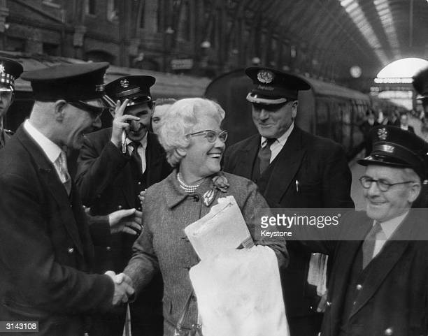 Cissie Charlton is greeted by station staff at King's Cross London on the day her two sons Bobby and Jackie are to play for England in the World Cup...