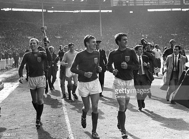 England captain Bobby Moore and colleague Geoff Hurst lead the team around the pitch at Wembley after their 42 victory over West Germany in extra...