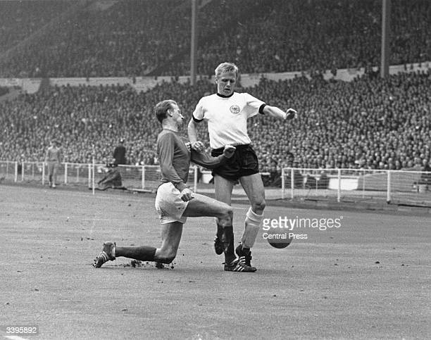 England midfielder Jackie Charlton tackles the West German forward Held during the 1966 World Cup Final at Wembley Stadium in London