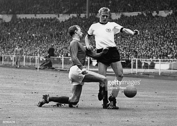 England's Jackie Charlton tackling West Germany's Held during the World Cup Final at Wembley which England won 42