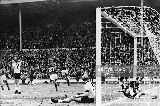 England's Martin Peters throws his arms in the air after scoring England's second goal in the World Cup Final against West Germany at Wembley Stadium...