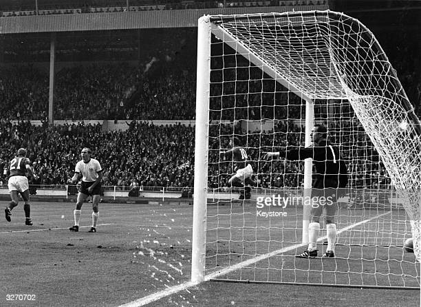 Geoff Hurst of England jumps for joy after scoring England's first goal during their World Cup Final match against West Germany at Wembley Stadium...