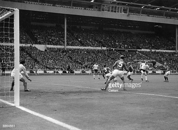 Helmut Haller puts West Germany 1-0 ahead during the World Cup Final against England at Wembley Stadium. Also in the picture are Gordon Banks in goal...