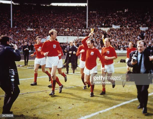 The England team raise the Jules Rimet trophy in the air following their 42 victory after extra time over West Germany in the World Cup Final at...