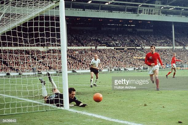The West German goalkeeper Hans Tilkowski saves a shot during the World Cup Final against England at Wembley Stadium London