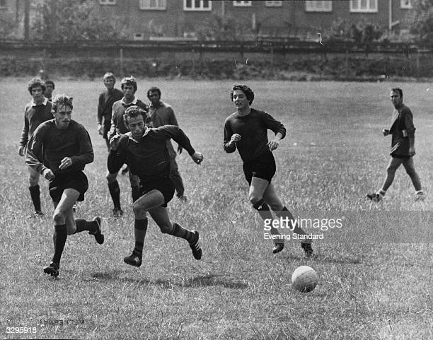 Footballers John Cushley Clive Charles Billy Bond Geoff Hurst John Charles Jimmy Greaves Mordechal Spiegler John McDowell and others chasing a ball...