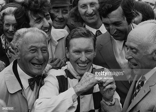 Australian jockey Bill Pyers showing off the ring which he was presented with after winning the King George VI and Queen Elizabeth Stakes at Ascot