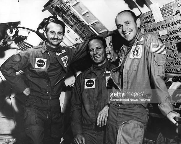 From left Dr Owen K Garriott science pilot Jack R Lousma pilot and Alan L Bean the Skylab III commander inside Skylab before the launch from Cape...