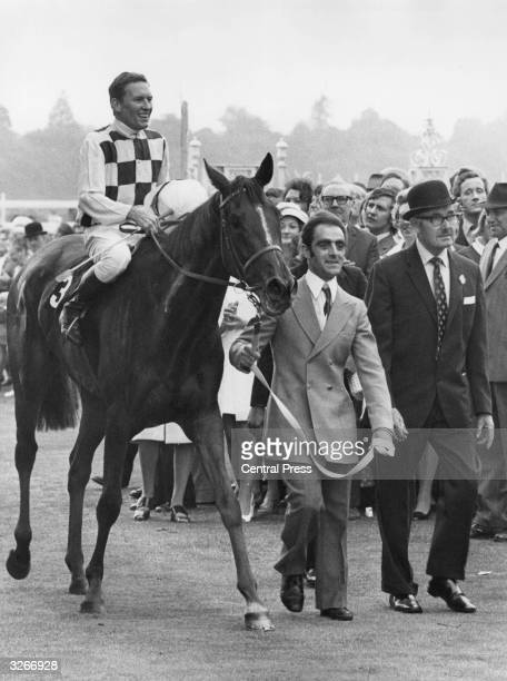 Race horse Dahlia after winning at Ascot. Jockey Bill Pyers rides.
