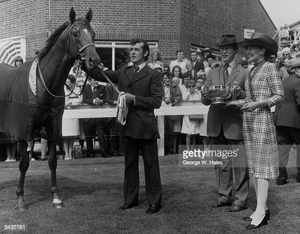 Mrs W M Vernon presenting Colonel hastings with the Rose Bowl after 'Red Alert' won the Spillers Stewarts Cup at Goodwood