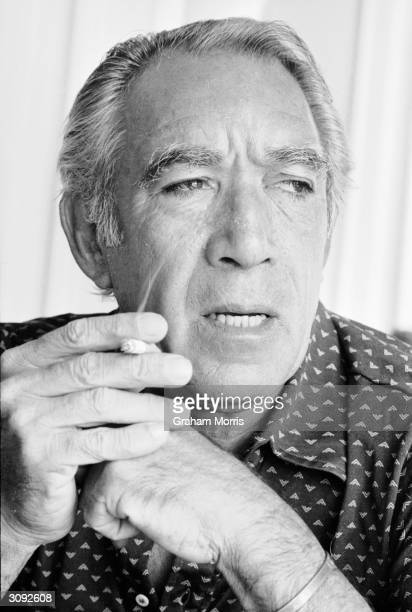 Actor Anthony Quinn smoking a cigarette