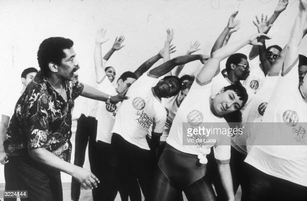 American dancer and choreographer Alvin Ailey instructs students during a class for the blind and visually impaired New York City Ailey founded the...