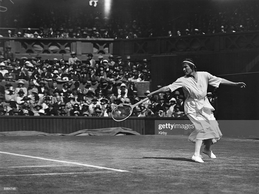 American-born tennis player Bunny Ryan (Elizabeth Ryan) in action against Suzanne Lenglen of France during a women's singles match at Wimbledon. As a women's doubles team Ryan and Lenglen won Wimbledon six times.