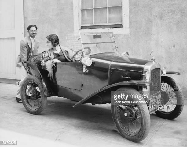 Mexican leading lady Dolores Del Rio has a helping hand starting her car