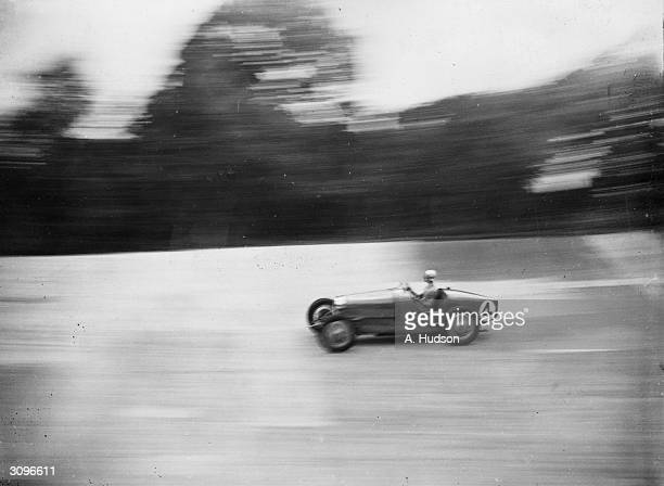 Dudley Froy takes B Wickens' Type 37A Bugatti for a trial run at Brooklands the day before the British Empire Trophy meeting