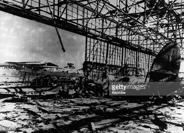 Damage was sustained following the Japanese bombing of Port Darwin An American Hudson Bomber lies in the ruins of one of the hangars damaged in the...