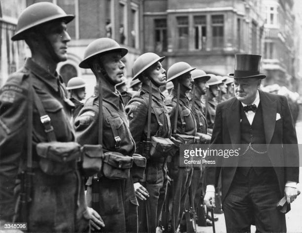British Prime Minister Winston Churchill inspecting the Guard of Honour at the Guildhall London where he is to receive the freedom of the city