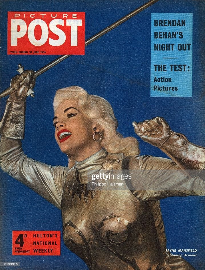 American actress Jayne Mansfield (1933 - 1967) brandishes a silver sword on the cover of Picture Post magazine. The headlines above read 'Brendan Behan's Night Out' and 'The Test: Action Pictures'. Original Publication: Picture Post Cover - Big American Dream - pub. 1956