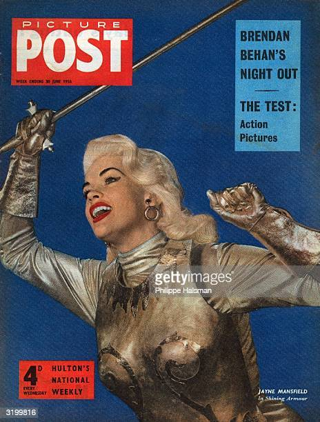 American actress Jayne Mansfield brandishes a silver sword on the cover of Picture Post magazine The headlines above read 'Brendan Behan's Night Out'...