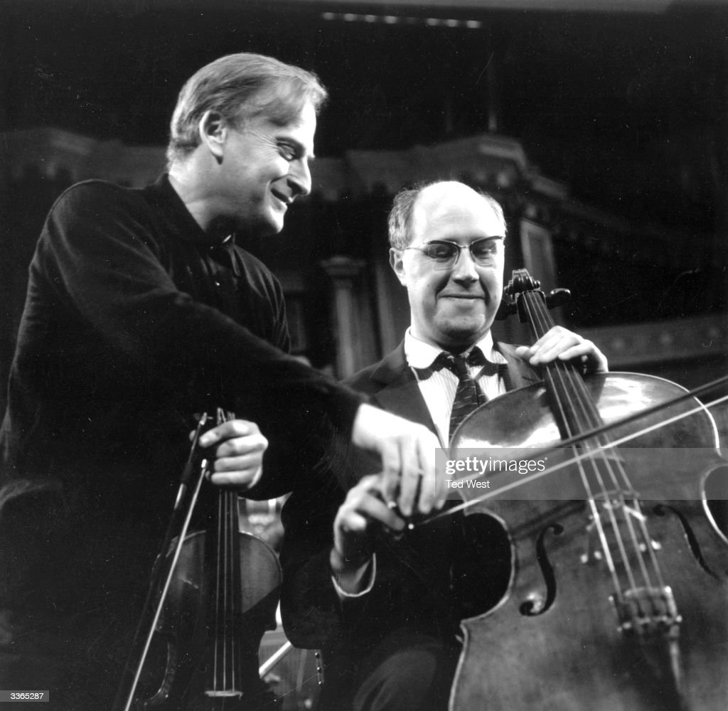 Violinist and conductor Yehudi Menuhin (1916 - 1999) and Russian cellist, pianist and conductor Mstislav Rostropovich rehearsing at the Royal Albert Hall, London.