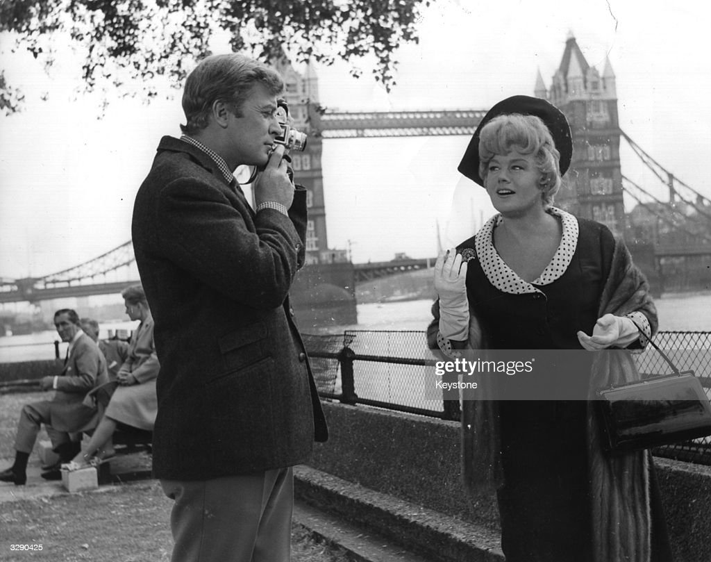 American actress Shelley Winters and English actor Michael Caine on location at Tower Bridge during the shooting of the film 'Alfie'.