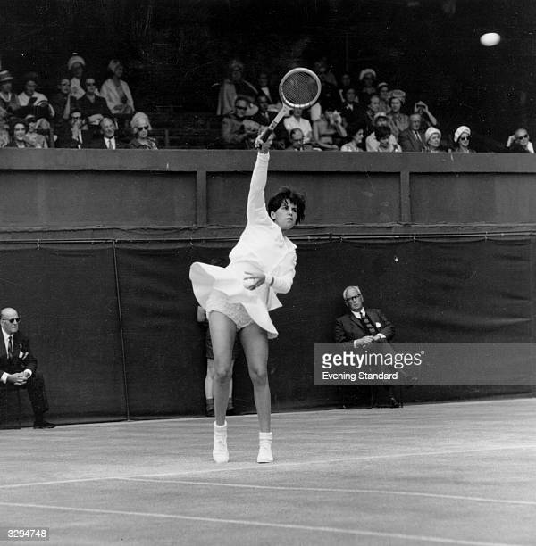 Brazilian tennis player Maria Bueno reaches for a high ball during a match at the Wimbledon Lawn Tennis Championships