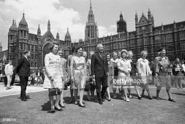 British prime minister Edward Heath with 13 of the 15 newly elected Conservative women MPs outside the House of Commons in London This is the largest...