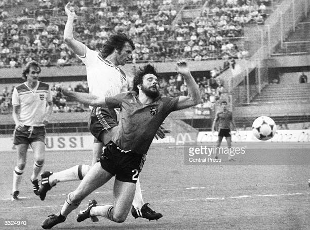 Footballer Watson of the English national side knocks Belgian player Gerets out of the way during match in the European Football Championships at...