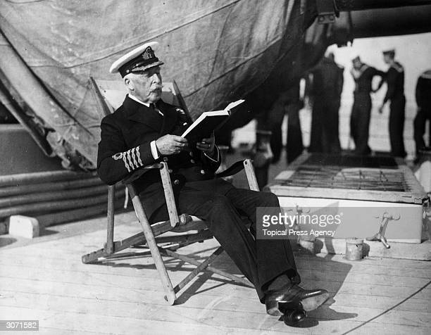 The Duke of Connaught 3rd son of Queen Victoria in naval uniform as he reads a book on the deck of HMS Malaya