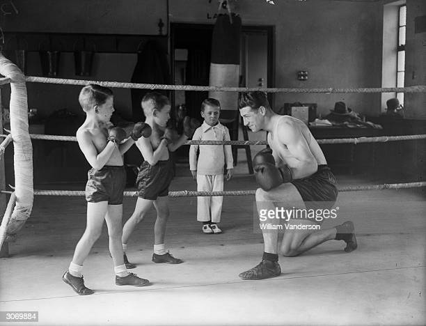 British middleweight boxing champion Len Harvey has two very small boxers at his training quarters they are known as 'Tom Young's Dreadnoughts' and...