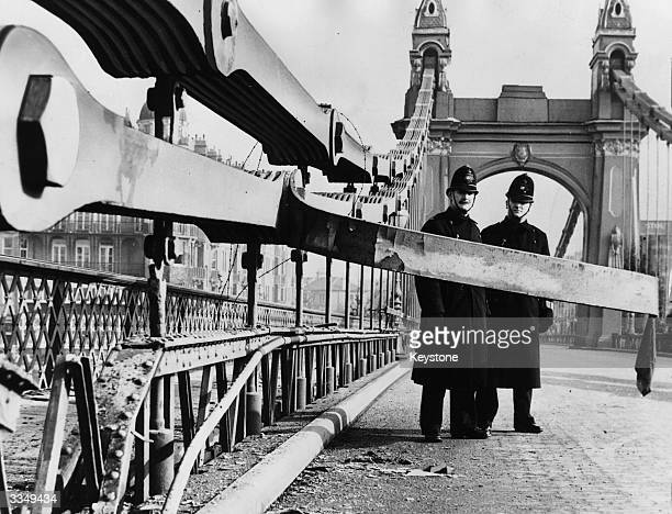 Two policemen on Hammersmith Bridge London after the explosion of a bomb planted by the IRA