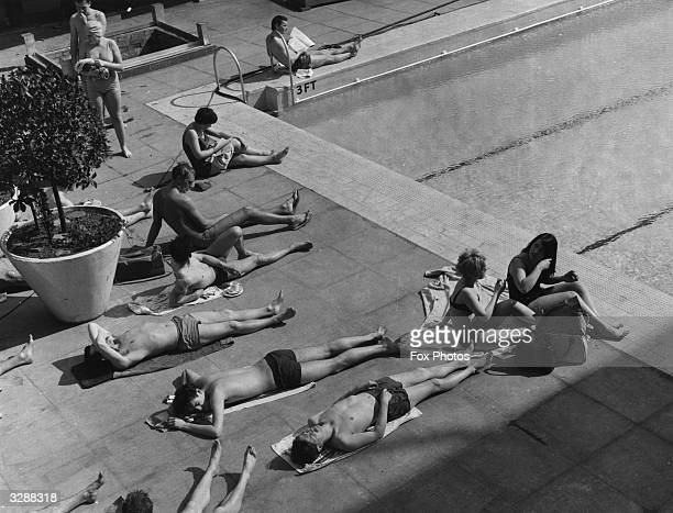 Sunbathers on the verandah at the outdoor pool at the Oasis lido in Holborn.