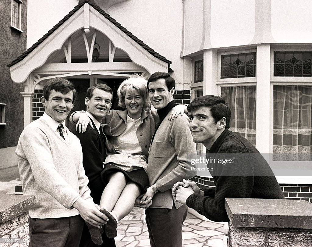 30th March 1966, Christine McCann gets a lift from Chelsea footballers (left to right) John Hollins, Eddie McCreadie and George Graham, On the far right Christine+s husband to be, Terry Venables smiles after he enlisted the help of the other players to he : News Photo