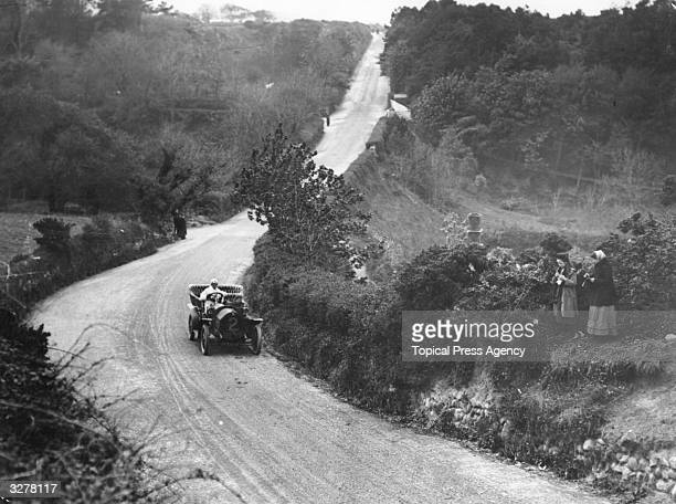 A Lee Guinness in an 18 hp Darracq on the dip into Kirkmichael during the Tourist Trophy on the Isle Of Man