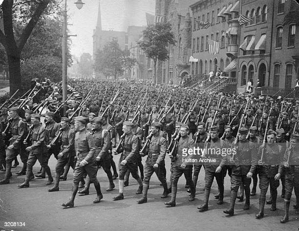 World War I victory parade of armed soldiers on Broad Street in Newark NJ