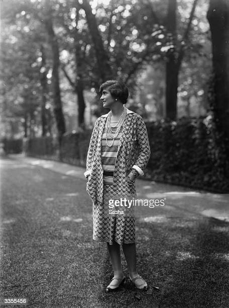 Designer Gabrielle 'Coco' Chanel , wearing one of her suits in the grounds at Fauborg, St Honore, Paris.