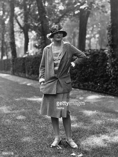 Influential French fashion designer Coco Chanel, real name Gabrielle Bonheur Chanel, modelling a Chanel suit at Fauborg, St Honore, Paris.