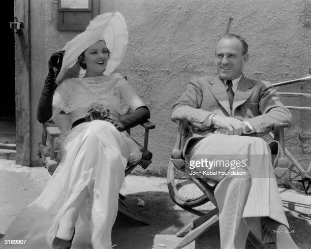 American actress Myrna Loy with film director Sam Wood during the making of 'Stamboul Quest'