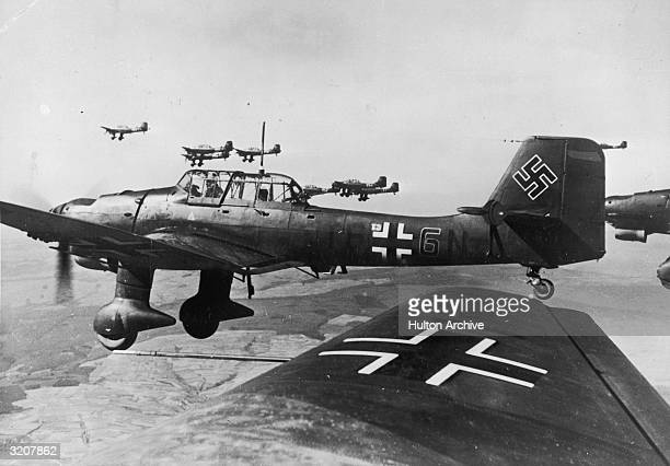 German Junkers Ju87B2 Stuka dive bombers of the Luftwaffe 5 Staffel/Stukageschwader 2 fly in formation over France during World War II The close air...