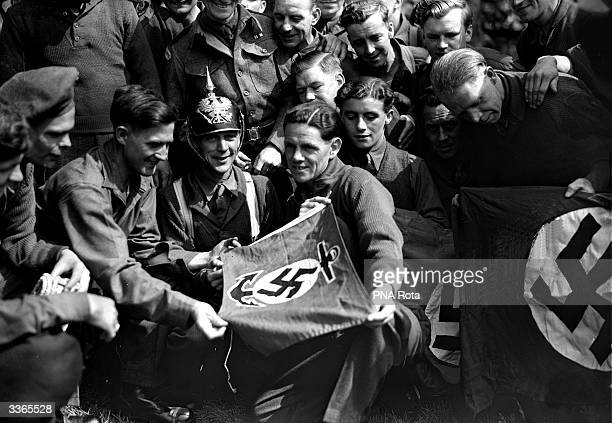 British prisoners of war from camps in Russian territory have arrived home A group of the released prisoners with some of their souvenirs CMS Sutton...
