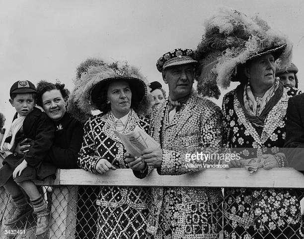 Coster King and Queen, Mr and Mrs J Marriott with their daughter, Marie Louise in full regalia for a visit to the Derby at Epsom.