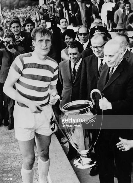 Billy McNeill of Celtic receives the European Cup trophy from the President of Portugal after the Scottish side's 2-1 victory over Inter Milan in...