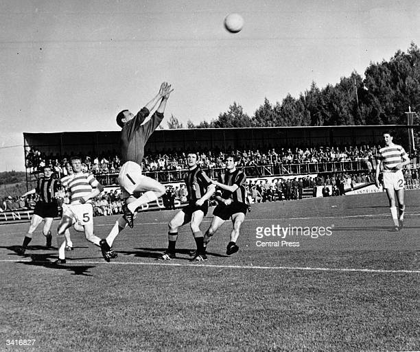Celtic's goalkeeper, Ronnie Simpson, jumps to catch a high ball from Inter Milan during the European Cup final in Lisbon. Tommy Gemmell and Stevie...