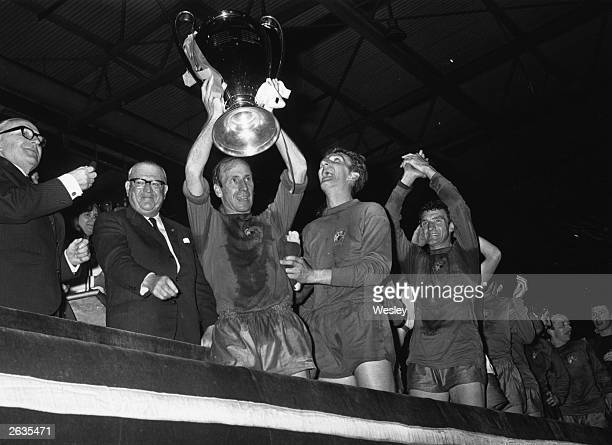 Bobby Charlton of Manchester United holds aloft the European Cup after his team's 41 victory over Benfica in the final at Wembley