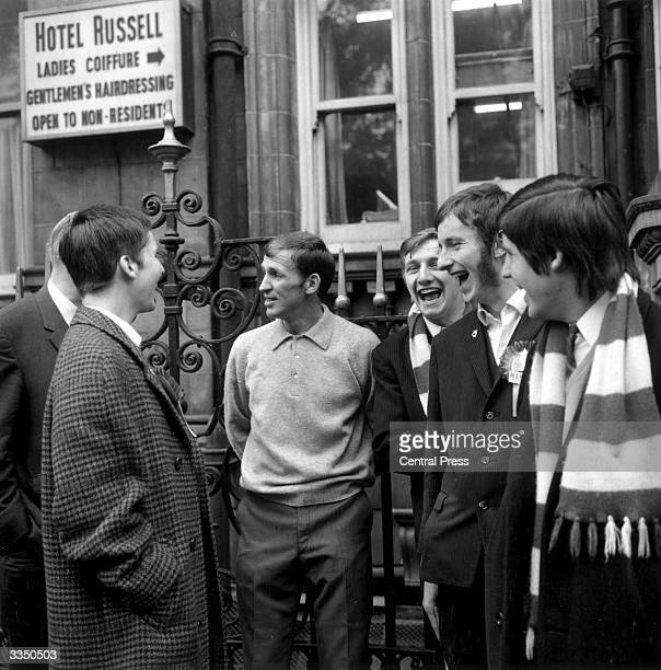 Manchester United Football Club midfield player, Pat Crerand talking to fans outside London's Hotel Russell after defeating Portuguese Football Club,...
