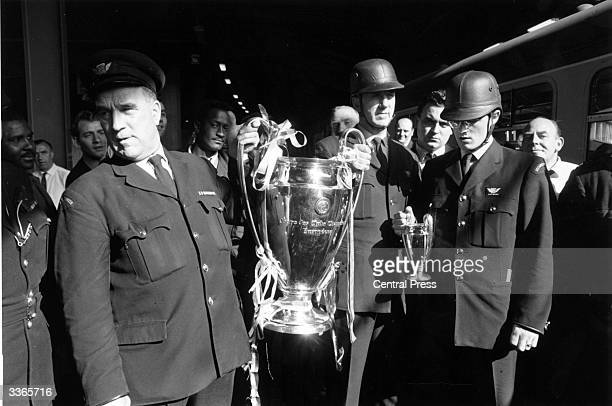 The European Cup is escorted to Britain following Manchester United's 41 victory over Benfica in the European Cup final