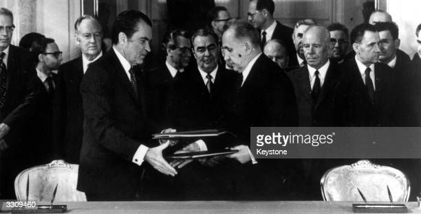 President Richard Nixon the 37th President of the United States exchanges cosmic space cooperation documents which have just been signed with Russian...