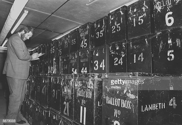 Len Lewis assistant to the officer in charge of voting checks the ballot boxes ahead of Britain's first ever referendum when they will vote on...